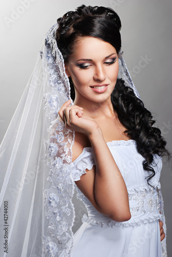 beautiful bride is standing in wedding dress