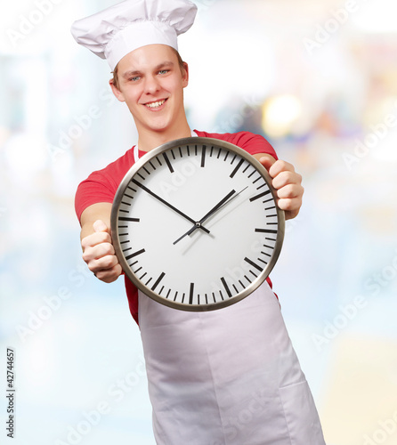 Chef Holding A Big Clock