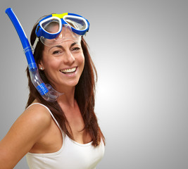 portrait of a happy middle aged woman wearing snorkel and goggle