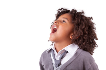 Portrait of a cute african little boy screaming