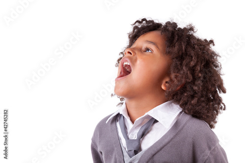 Portrait of a cute african little boy screaming