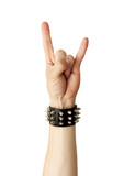 Hand of rocker in  leather bracelet.