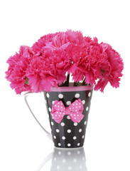 Bouquet of carnations in a cup isolated on white