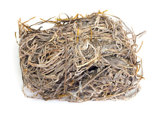 A pile of dried laminaria (kelp) isolated on a white background