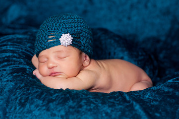 Newborn Baby Girl Wearing a Teal Flapper Style Hat