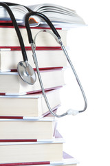 Stack of books and a stethoscope medical on a white background.