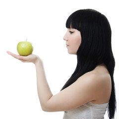 Portrait of a beautiful woman, holding an apple