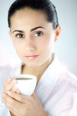 Beautiful Young Woman With White Cup of Coffee