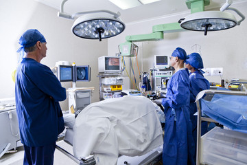 Surgery room with surgeon and nurses