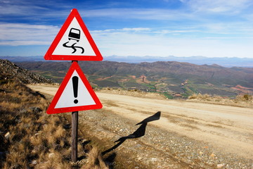 Warning signs on a mountain pass