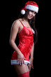 very sexy christmas woman with red santa look on black backgroun