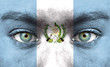 Human face painted with flag of Guatemala