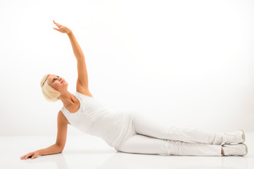 White fitness woman stretch body at Pilates.