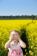 Little girl on yellow field