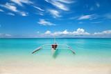 Fototapety White boat on a tropical beach
