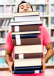 Man carrying heavy books
