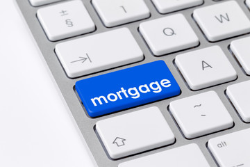 Keyboard with one blue button with the word mortgage