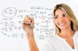 Female student writing formulas