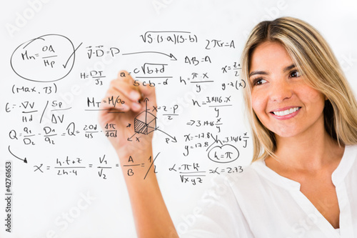 Female student writing formulas