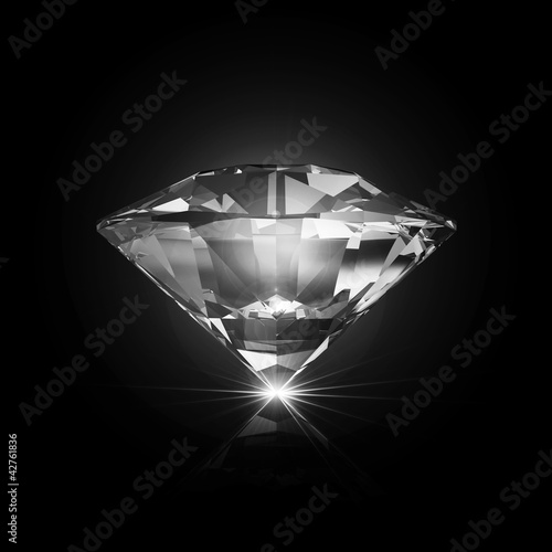 Diamond on black background with glowing rays