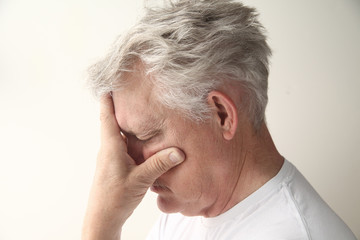side view of man who is embarrassed or disappointed