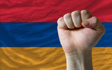 Hard fist in front of armenia flag symbolizing power