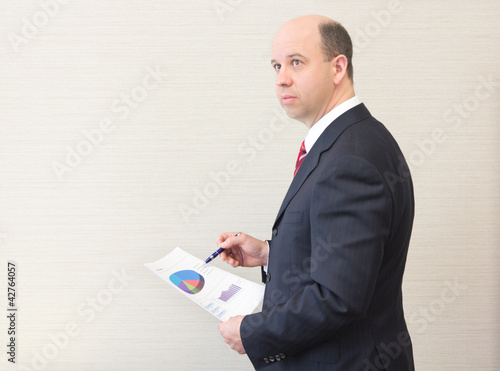 Business man holding a document