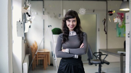 Portrait of young beautiful businesswoman in modern office