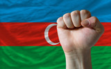 Hard fist in front of azerbaijan flag symbolizing power