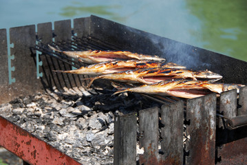 appetizing grilled fish on barbecue