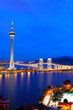 Cityscape in night with famous travel tower near river in Macao,
