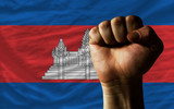 Hard fist in front of cambodia flag symbolizing power