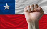 Hard fist in front of chile flag symbolizing power