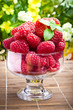 Sweet fresh raspberry fruits in glass goblet