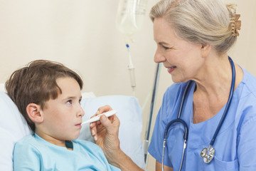 Nurse or Doctor Taking Temperature of Young Boy Child Patient