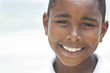 Happy African American Boy On Beach