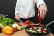 Chef adding ingredients