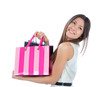 woman with shopping bags after successful shopping, smiling
