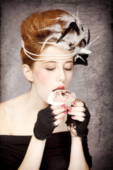Redhead girl with Rococo hair style and cake in studio at vintag