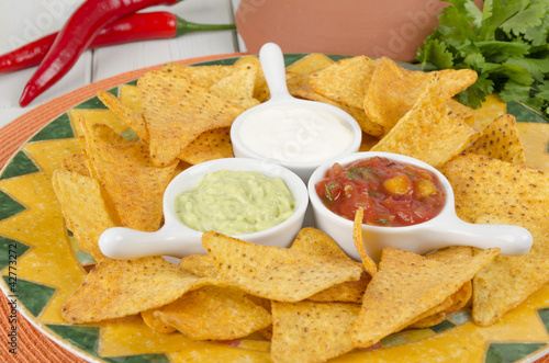 Nachos - Tortilla Chips with guacamole, salsa & sour cream dips