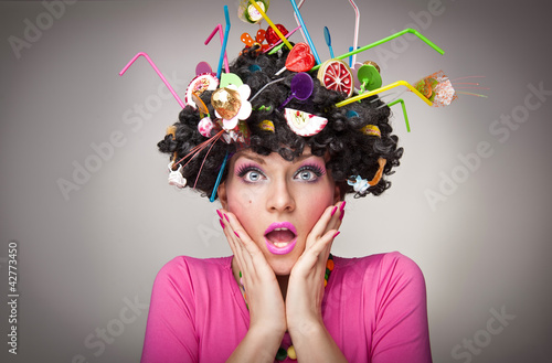 beautiful  surprised female  with lollipops in the hair
