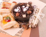 Coffee beans and cinnamon, nuts, fruit cake on background