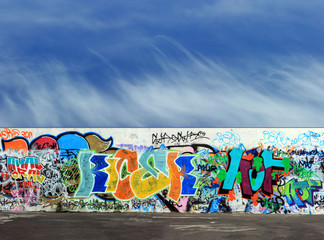 Graffiti wall and asphalt floor abstract background