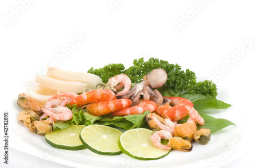 Raw cocktail of seafood with vegetables