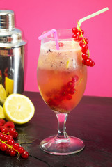 fruit cocktail with mixer over pink background