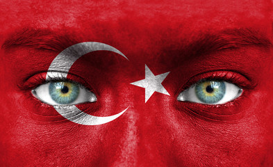Human face painted with flag of Turkey