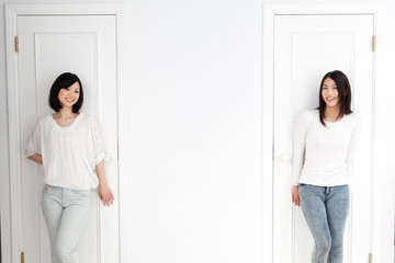 a young asian women with 2 doors