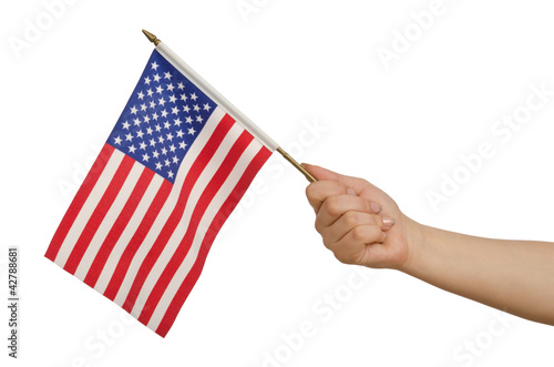 Hand holding american flag on white