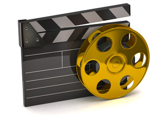Movie clapper board and golden film reel