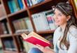 Pensive woman reading a book
